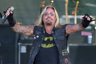 Vince Neil Reportedly Injured After Falling Off Stage